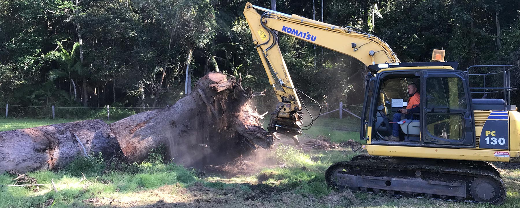 Heavy Machinery Moving Tree Trunk
