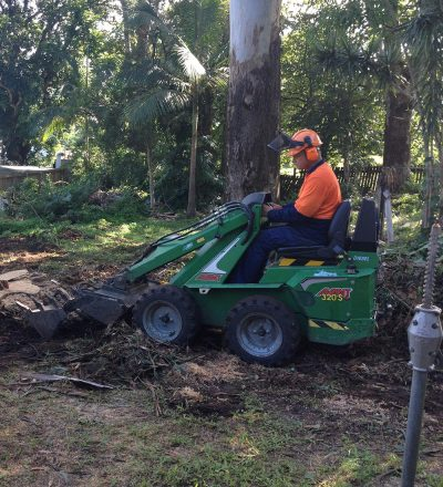 Man Operating Bobcat